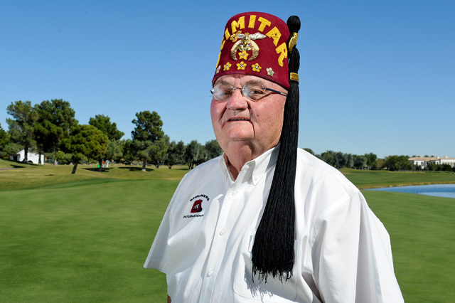 Gary Dunwoody, chairman of the Shriners Hospitals for Children Open golf tournament, poses for a photo on the 18th green of TPC Summerlin in Las Vegas on Wednesday. (David Cleveland/Las Vegas Revi ...