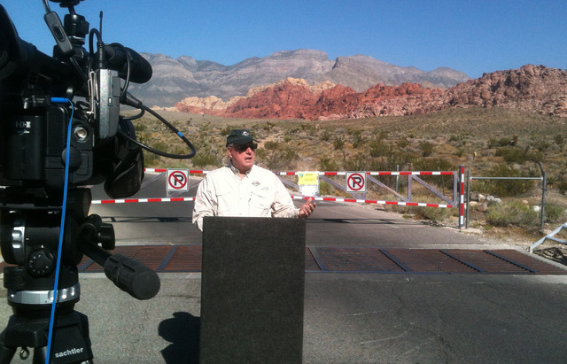 Richard Scown from Pink Jeep Tours of Las Vegas speaks to reporters in front of the locked gate at Red Rock Canyon National Conservation Area during a press conference Thursday, Oct. 3, 2013,  on  ...