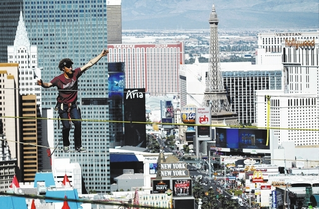 Daredevil slackline athlete Andy Lewis sets the world record for the longest urban highline walk outside the 63rd floor of the Mandalay Bay in Las Vegas on Oct. 16 , 2013. Lewis' record walk was ...