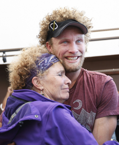 Daredevil slackline athlete Andy Lewis gets a hug from his relieved mom Lynn after setting the world record for the longest urban highline walk outside the 63rd floor of the Mandalay Bay in Las Ve ...