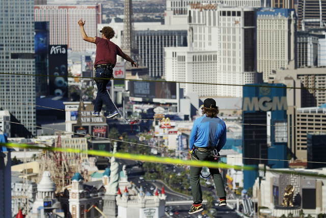 Daredevil slackline athlete Andy Lewis sets the world record for the longest urban highline walk outside the 63rd floor of the Mandalay Bay in Las Vegas on Oct. 16 , 2013. Lewis' record walk was 4 ...
