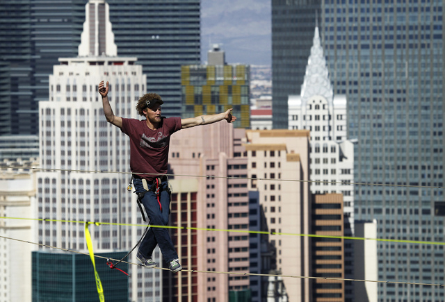 Daredevil slackline athlete Andy Lewis sets the world record for the longest urban highline walk outside the 63rd floor of the Mandalay Bay in Las Vegas on Oct. 16 , 2013. (Jason Bean/Las Vegas Re ...