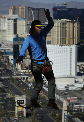 With the Strip in the background, daredevil slackline athlete Mickey Wilson braves an urban highline walk outside the 63rd floor of the Mandalay Bay in Las Vegas on Oct. 16 , 2013. (Jason Bean/Las ...