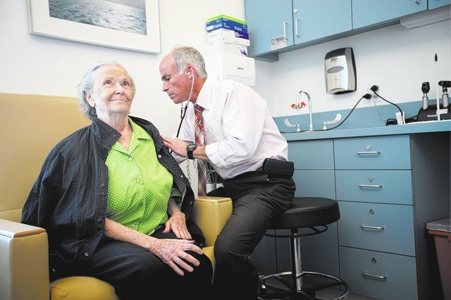 Summerlin resident Pat, left, who has posterior cortical atrophy, a variant of Alzheimer's disease, undergoes a medical examination by Dr. Charles Bernick, associate medical director at the Clev ...