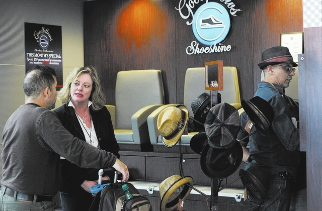 Goodfellows Shoeshine & Accessories President and CEO Shelley Bonner-Carson, second from left, talks with a customer while checking on one of her McCarran Airport locations in Las Vegas on Sept. 2 ...