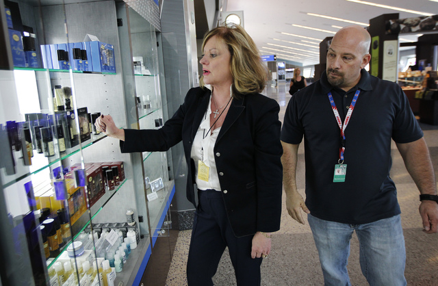 Goodfellows Shoeshine & Accessories President and CEO Shelley Bonner-Carson, left, inspects a display case with her Las Vegas manager Michael Vece while checking on one of their McCarran Internati ...