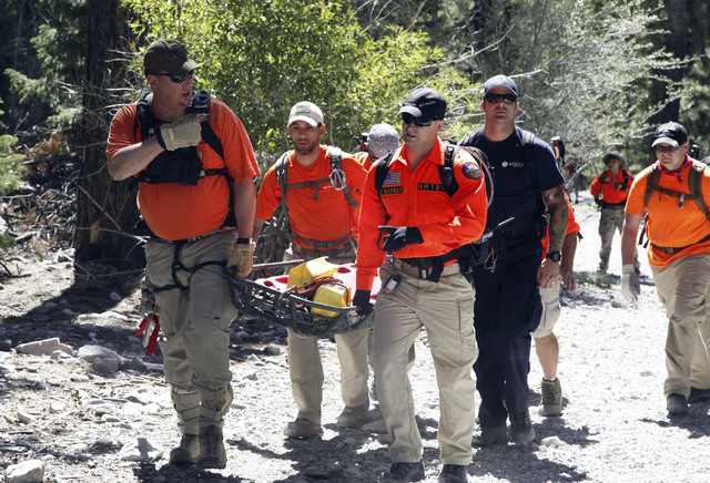 Members of Red Rock Search and Rescue are seen in this August 2013 photo during a rescue exercise at Mary Jane Falls on Mount Charleston. The group recently acquired new headquarters, compliments  ...