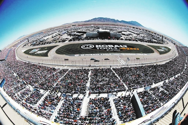 JASON BEAN/LAS VEGAS REVIEW-JOURNAL FILE PHOTO As shown through a fisheye lens, the crowd watches the opening laps of the NASCAR Sprint Cup Series Kobalt Tools 400 at the Las Vegas Motor Speedway, ...