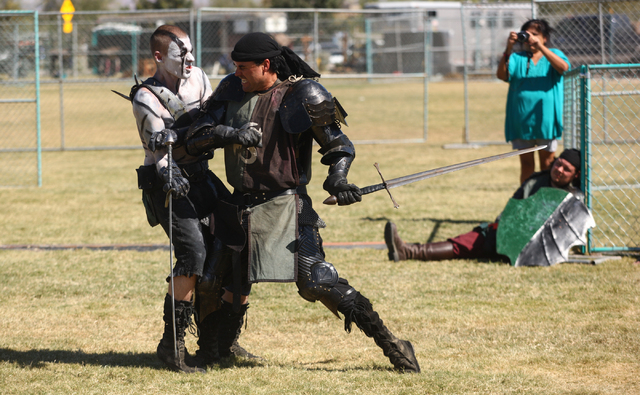 Soldiers battle during a reenactment on the Field of Honor during the Age of Chivalry Renaissance Festival, Oct. 13. (Chase Stevens/View)