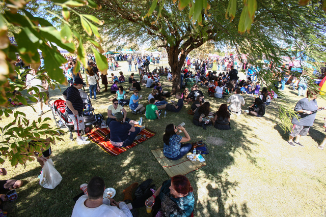 Attendees take a break in the shade during the Age of Chivalry Renaissance Festival, Oct. 13. (Chase Stevens/View)