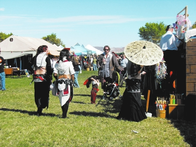 Festivalgoers stroll through the merchant's tents on Oct. 7, 2011 at the Age of Chivalry Renaissance Festival  that took place at Silverbowl Stadium that year.  This year the festival returns to S ...