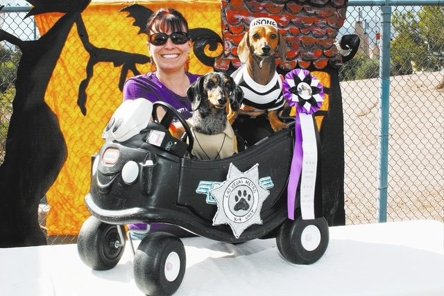 Stacy Twigg poses with two dachshunds after winning first place in the Halloween costume contest at the Family, Fur & Fun Festival in October 2012 at Exploration Peak Park, 9600 S. Buffalo Drive,  ...