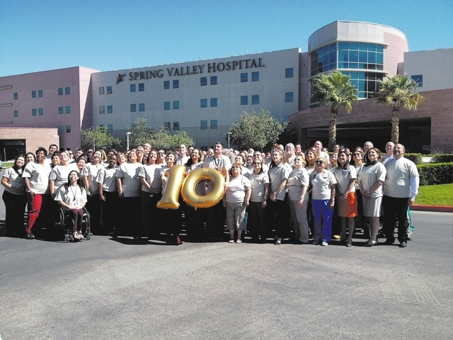 Spring Valley Hospital staff pose for a photo in the hospital's parking lot, 5400 S. Rainbow Blvd., in Las Vegas, on Oct. 2, 2013. The hospital recently celebrated its 10th anniversary. (Caitlyn B ...