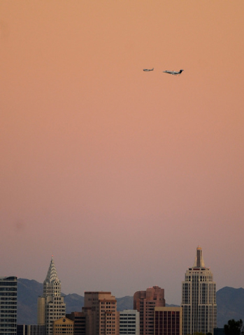 DrVita.com CEO Wayne Gorsek flys his Embraer Phenom 300 private jet, right, over the Las Vegas Strip during a sunset photo shoot on Monday, Oct. 21, 2013. The FAA provided a dispensation to allow  ...