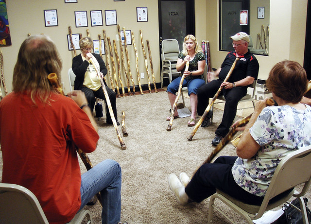 Instructor Rick Dusek, far left, teaches Judith Pinkerton, Amy Frost, Ross Bryant and Martha Kibler, left to right, how to play the didjeridu Sept. 20, 2013, at a class at Music 4 Life, 2975 S. Ra ...
