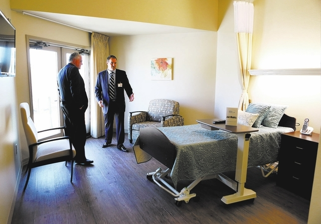 Clark County commissioner Steve Sisolak, left, is guided by Darren Bertram, right, CEO of Infinity Hospice Care during a tour of the new patient facility Thursday, Oct. 10, 2013, in Las Vegas. Inf ...