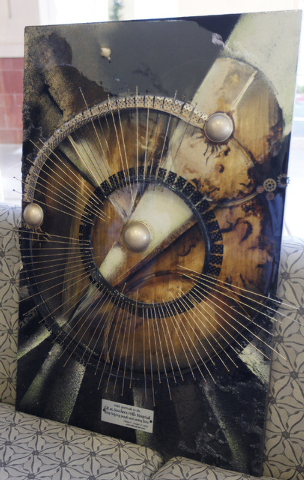 Artist Violeta Veltcheva donates an original piece of work to the Southern Hills Hospital in Las Vegas on Oct. 17, 2013. (Jason Bean/Las Vegas Review-Journal)