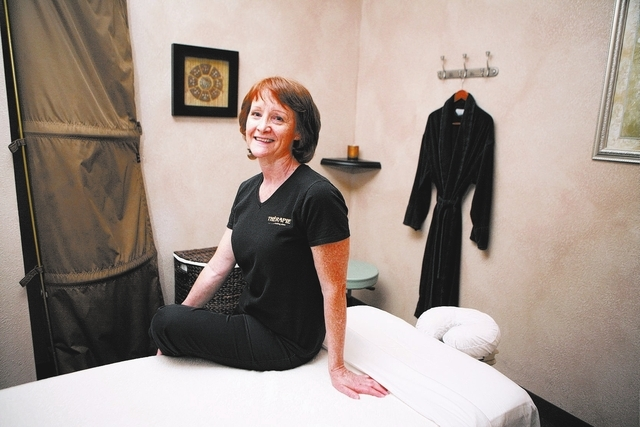 Sally Spurgeon, licensed massage therapist and owner of Therapie, sits in a room at Therapie Tuesday, July 30, 13, in Las Vegas. Therapie, which is located at 6819 W. Tropicana Ave. #200, offers u ...