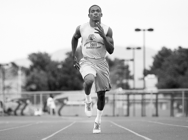 Sprinter Jayveon Taylor runs during practice at Bonanza High School in Las Vegas on March 7, 2013. (Jason Bean/Las Vegas Review-Journal)