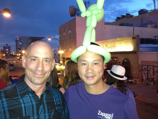 Tony Hsieh wears a balloon hat in downtown Las Vegas. At left is Michael Morton, co-owner of La Comida. (Norm Clarke photo)