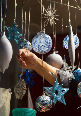 """David Henault (cq) finishes hanging a display inside The Tree Lot at Crate and Barrel, a temporary holiday store by the retailer, Tuesday, Oct. 29, 2013 at Town Square. The """"pop-up shop"""" ..."""