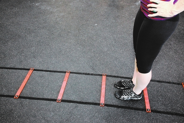 Trainer Laura Salcedo demonstrates the finishing position for the agility ladder exercise at CrossFit Mountains Edge in Las Vegas on Wednesday, Oct. 2, 2013. (Justin Yurkanin/Las Vegas Review-Journal)