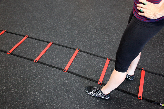 Trainer Laura Salcedo demonstrates the middle position for the agility ladder exercise at CrossFit Mountains Edge in Las Vegas on Wednesday, Oct. 2, 2013. (Justin Yurkanin/Las Vegas Review-Journal)