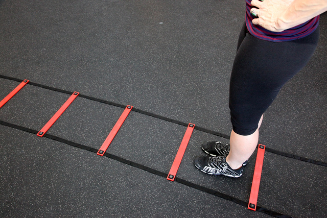 Trainer Laura Salcedo demonstrates the starting position for the agility ladder exercise at CrossFit Mountains Edge in Las Vegas on Wednesday, Oct. 2, 2013. (Justin Yurkanin/Las Vegas Review-Journal)