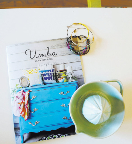 An Umba catalog and samples of artisan goods are shown. (Ronda Churchill/Las Vegas Review-Journal)
