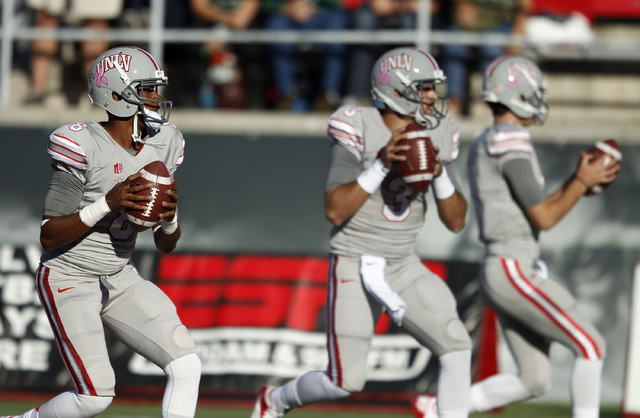 UNLV quarterback Caleb Herring, left, practices before a game against Hawaii at Sam Boyd Stadium in Las Vegas Saturday, Oct. 12, 2013. (John Locher/Las Vegas Review-Journal)
