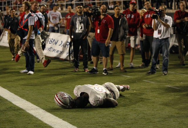 UNLV wide receiver Devante Davis lies on the ground after he was injured during a game against Hawaii at Sam Boyd Stadium in Las Vegas Saturday, Oct. 12, 2013. (John Locher/Las Vegas Review-Journal)
