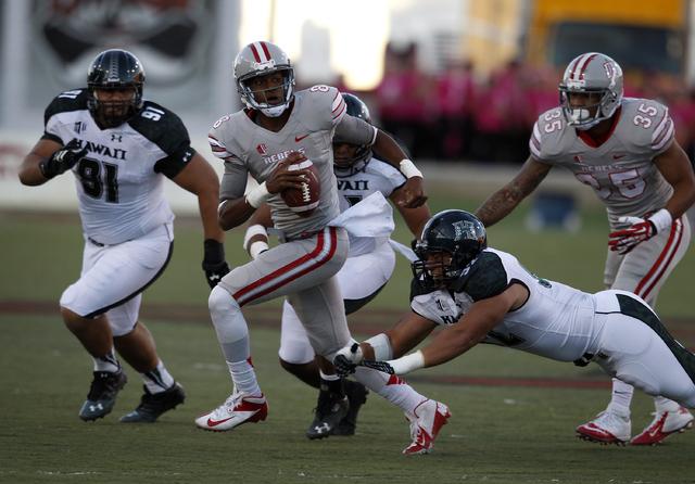 UNLV quarterback Caleb Herring runs for yardage during a game against Hawaii at Sam Boyd Stadium in Las Vegas Saturday, Oct. 12, 2013. (John Locher/Las Vegas Review-Journal)