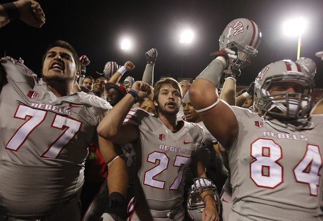 UNLV player Nolan Kohorst, center, celebrates with teammates after kicking the game winning field goal against Hawaii at Sam Boyd Stadium in Las Vegas Saturday, Oct. 12, 2013. (AP Photo/Las Vegas  ...