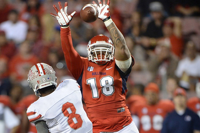 Fresno State nose tackle Andy Jennings pressures UNLV quarterback Caleb Herring in the Rebels' 38-14 loss Saturday. Herring completed 27 of 42 passes for 161 yards, and UNLV's 14-point output  ...