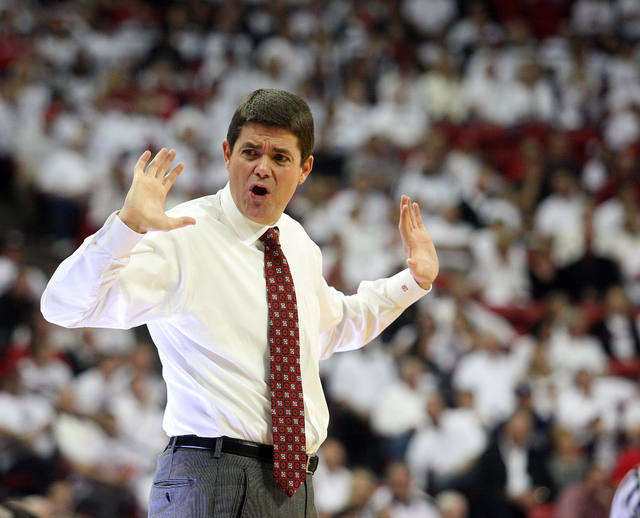 UNLV head coach Dave Rice reacts to a UNLV foul against Wyoming in the second half of an NCAA college basketball game, Saturday, March 3, 2012, in Las Vegas. (AP Photo/John Gurzinski)