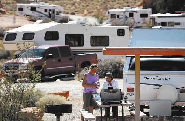 Charlotte Cramer, left, and Nancy Wormald of Vancouver, British Columbia wash dishes Friday, Oct. 11, 2013 at a campground at Valley of Fire State Park about 50 miles northeast of Las Vegas. The t ...