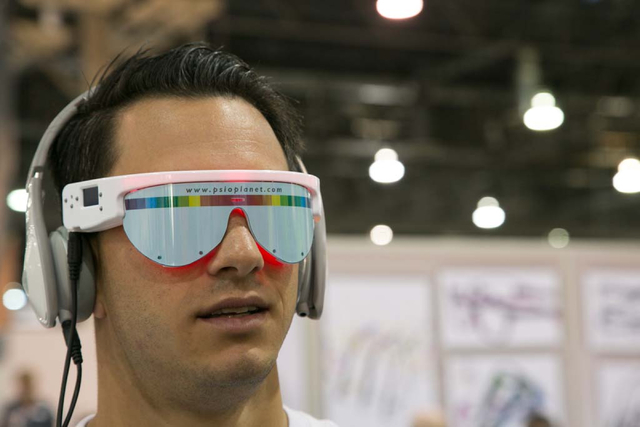 Ryan Masucci tries out a PSiO audio visual stimulation system at the Vision Expo West, in the Sands Expo Center of Las Vegas, Nev. on Oct. 4, 2013. PSiO's system brings the user feelings of relaxa ...