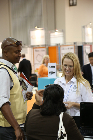 PSiO rep, Kelsey Butler, explains the her company's audio visual stimulation system at the Vision Expo West, in the Sands Expo Center of Las Vegas, Nev. on Oct. 4, 2013. PSiO's system brings the u ...