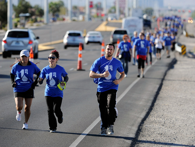 "Runners lead the pack of several hundred walkers during  One Drop's second annual ""Walk for Water"" along South Las Vegas Blvd. on Saturday, Oct. 5, 2013.  One Drop, established by Cirque ..."