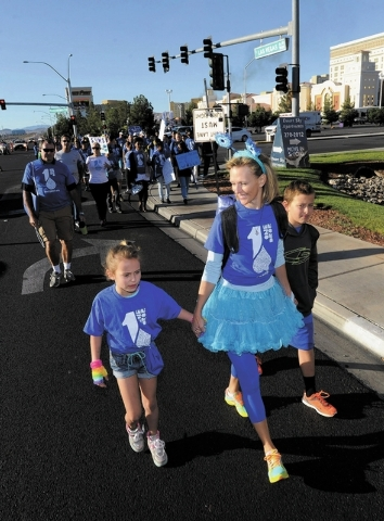 "Jenna Morton and her daughter, Petra Morton, walk during One Drop's second annual ""Walk for Water"" along South Las Vegas Blvd. on Saturday, Oct. 5, 2013.  One Drop, established by Cirque ..."