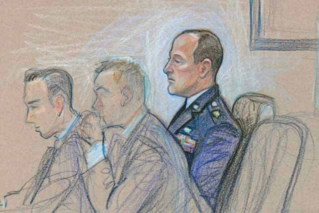 Maj. Charles Cox, right, accused in a sexual abuse and assault case involving an airman, appears at court-martial proceedings at Nellis Air Force Base on Tuesday. His attorneys include senior defe ...