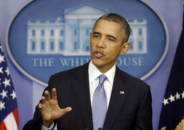 President Barack Obama, speaking Monday in the media briefing room of the White House, said a government shutdown would throw a wrench into the gears of U.S. economy. (AP Photo/Pablo Martinez Mons ...
