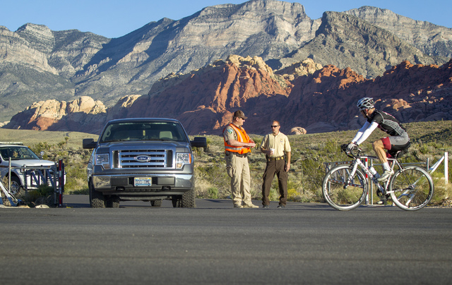 Bureau of Land Management officials man the entrance to the Red Rock Canyon National Conservation Area on Tuesday. The popular recreation area is closed because of the federal government budget im ...