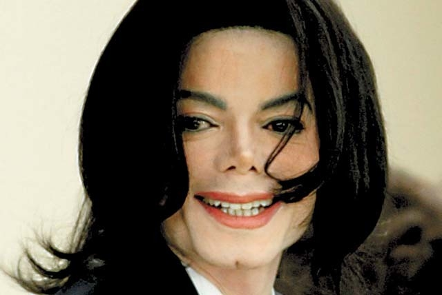 This March, 2005, file photo shows Michael Jackson arriving at the Santa Barbara County Superior Court in Santa Maria, Calif. A jury ruled on Wednesday that concert promoter AEG was not negligent  ...
