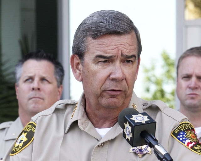 Las Vegas Metropolitan Police Sheriff Douglas Gillespie speaks to the media in front of Metro headquarters in Las Vegas, Friday, Oct. 11, 2013. Gillespie said he was offended by comments made by C ...