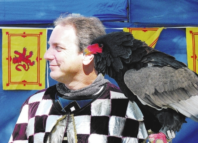 F. ANDREW TAYLOR/VIEW NEWS Bird trainer and performer Joe Krathwohl poses with his Bateleur Eagle on October 9 2009 at the Age of Chivalry Renaissance Festival in Sunset Park.