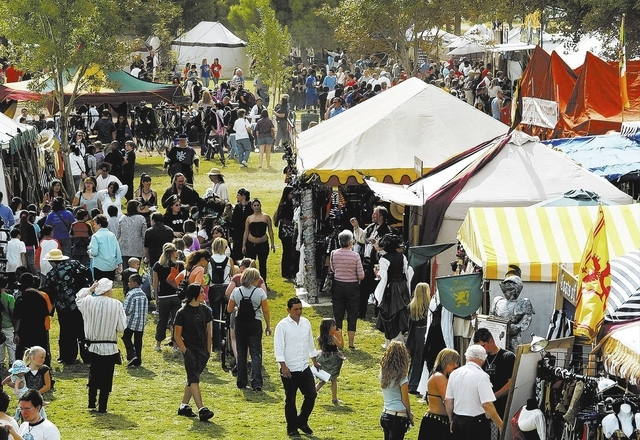 WH-SE-HE-CHILVARY-OCT23-Hundreds strolled back through time looking at the wares on the merchant's green at the 14th Annual Renaissance Fair held October 12-14 at Sunset Park.  View photograph by  ...