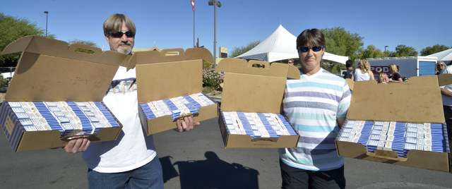 Joe and Barbara Sullivan pose with the 120 White Castle hamburgers they purchased for $120 during the Las Vegas Foodie Fest in the parking lot of the Silverton hotel-casino at 3333 Blue Diamond Ro ...