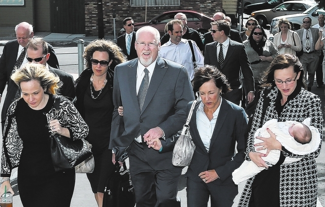 Surrounded by family and friends, Harvey Whittemore walks into federal court in Reno on Monday. (Cathleen Allison/Las Vegas Review-Journal)
