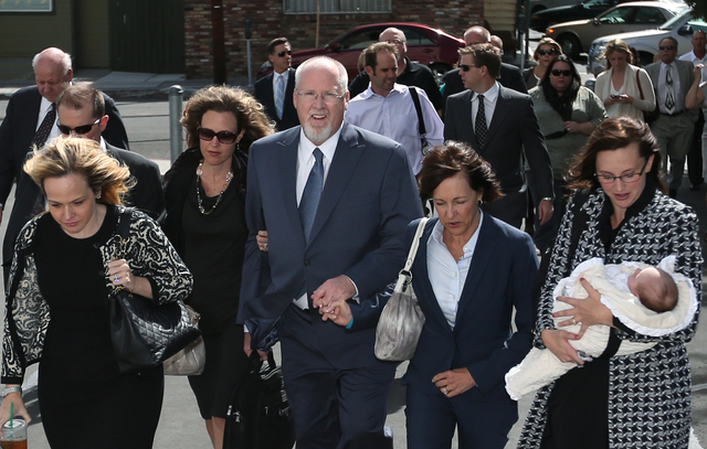 Surrounded by family and friends, Harvey Whittemore walks into federal court in Reno, Nev., on Monday. (Cathleen Allison/Las Vegas Review-Journal)